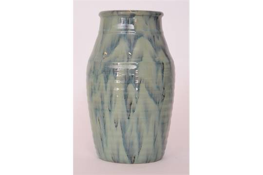 A 1930s Candy Ware ribbed vase decorated with a tonal streaked blue
