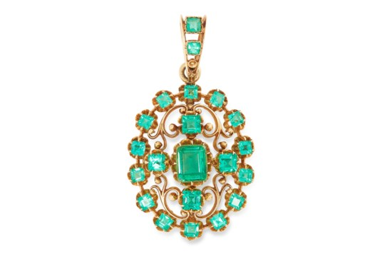 AN ANTIQUE EMERALD PENDANT in open scrolling design set with emerald and square cut emerald