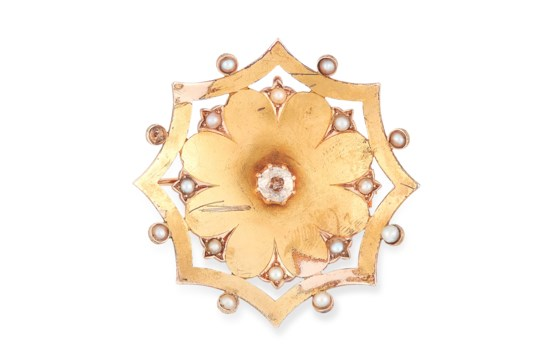 A DIAMOND AND PEARL BROOCH in floral design, set with a central round old cut diamond of 0.40 carats