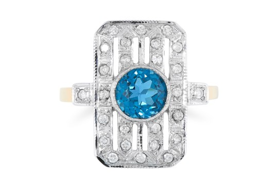 A TOPAZ AND DIAMOND DRESS RING in 18ct yellow gold, in Art Deco style, set with a round cut topaz of