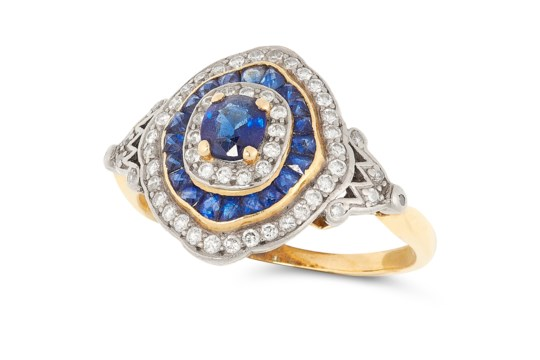 A SAPPHIRE AND DIAMOND TARGET RING, CIRCA 1950 in 18ct yellow gold, set with an oval cut sapphire in - Image 2 of 2