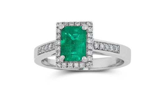 A COLOMBIAN EMERALD AND DIAMOND RING in platinum, set with a single emerald cut emerald of 0.91