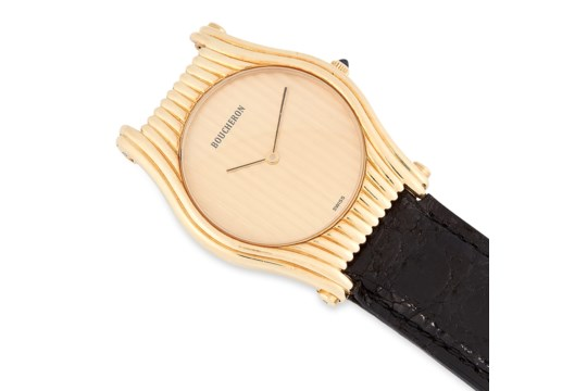 A LADIES WRIST WATCH, BOUCHERON in yellow gold, with gold dial and black leather strap, signed