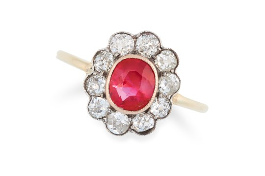 AN ANTIQUE 1.50 CARAT BURMA NO HEAT RUBY AND DIAMOND RING in high carat gold, set with a cushion cut