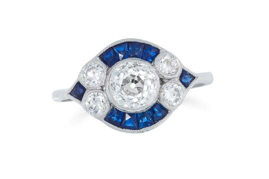 A DIAMOND AND SAPPHIRE RING set with round old cut diamonds and french cut sapphires, size N / 6.