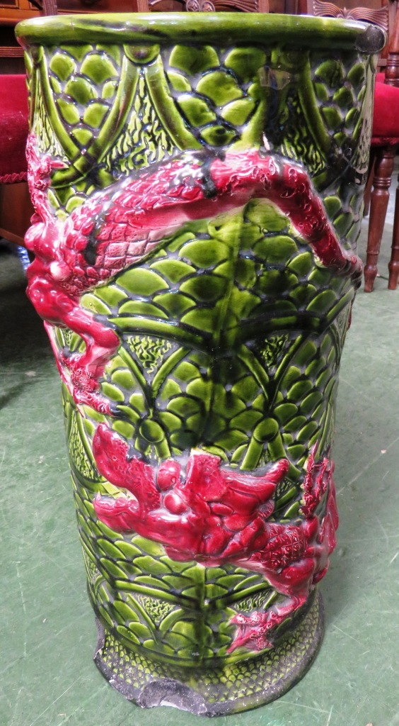 Lot 123 - GREEN AND RED GLAZED CERAMIC UMBRELLA AND STICK STAND DECORATED WITH DRAGON (A/F)