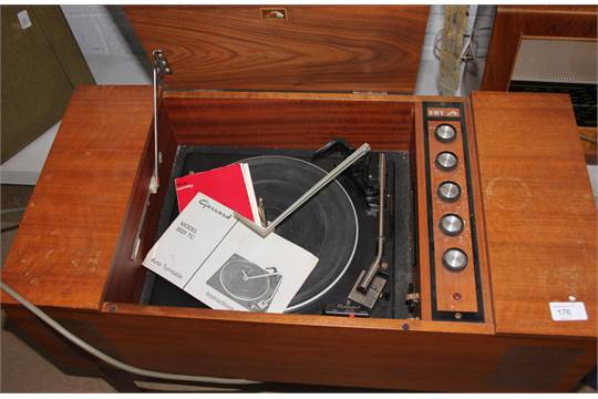 A teak cabinet cased HMV record player, having a four speed ...