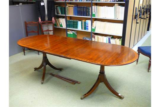 Reproduction Regency Style Extending Dining Table In Mahogany Finish On Twin Pedestals With Brass