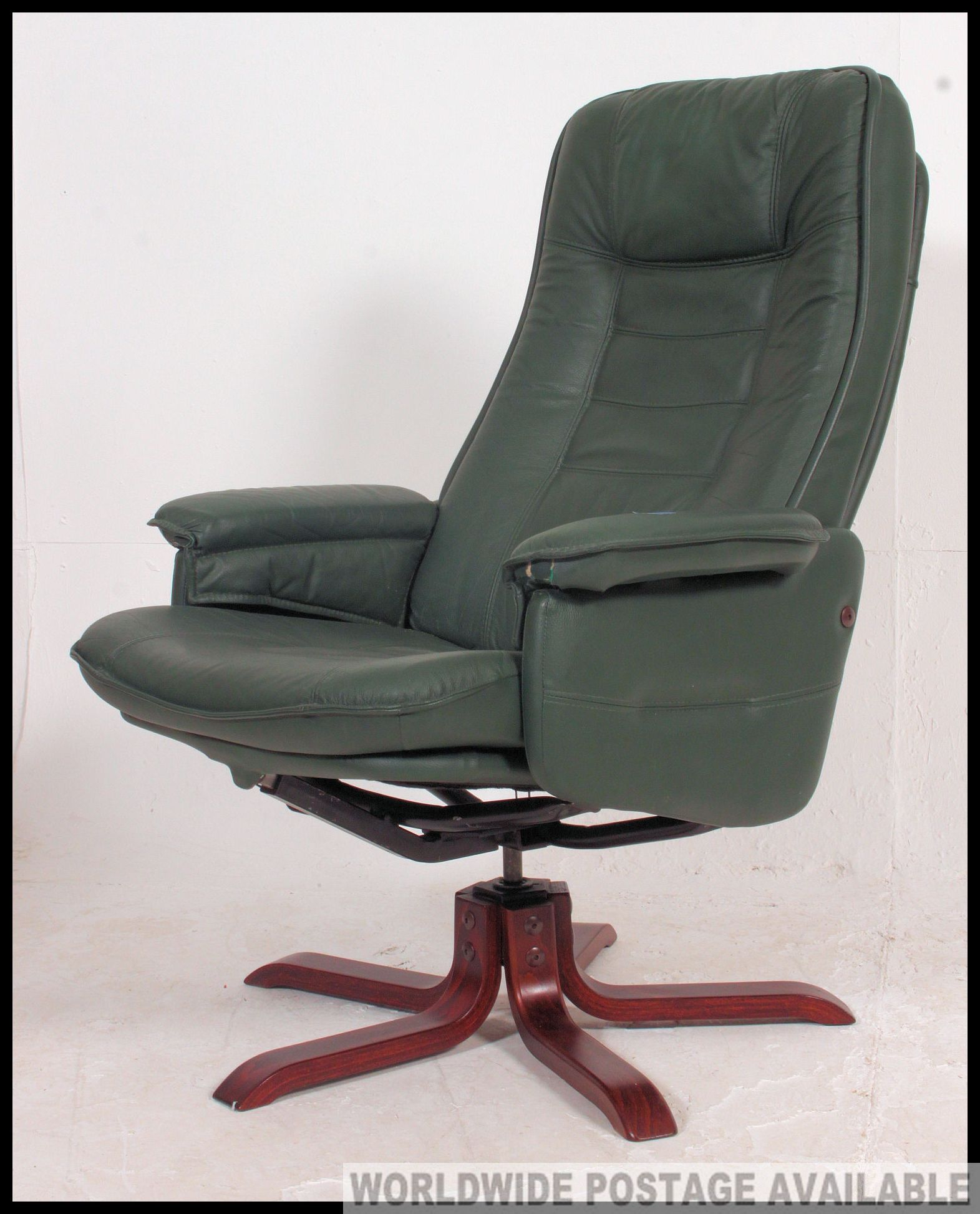 Pleasing A Green Leather Reclining Swivel Captains Chair By Quality Machost Co Dining Chair Design Ideas Machostcouk
