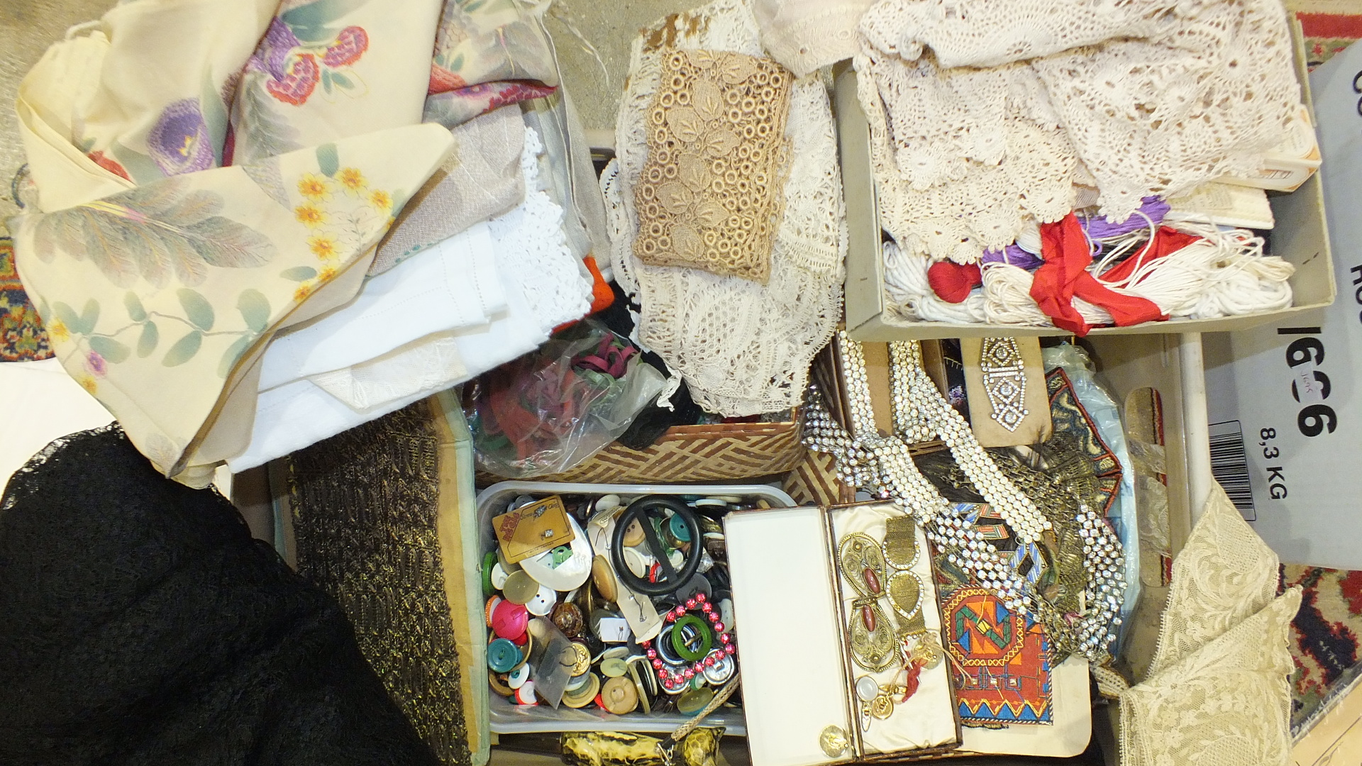 Lot 495 - A quantity of haberdashery, including lace, appliqué patches, buttons, paste buckles and