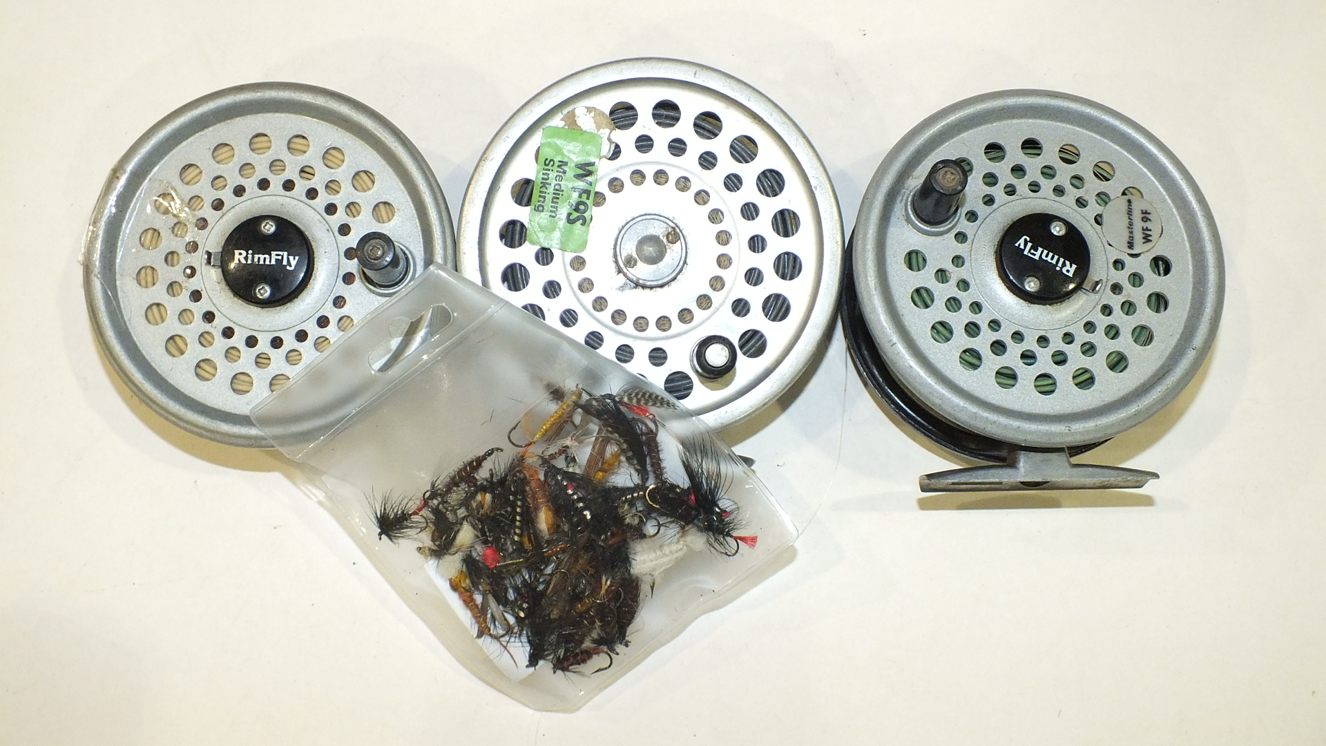 Lot 557 - A Hardy Marquis 10 alloy fly reel and line and a Rimfly fly reel with spare spool and two lines, etc