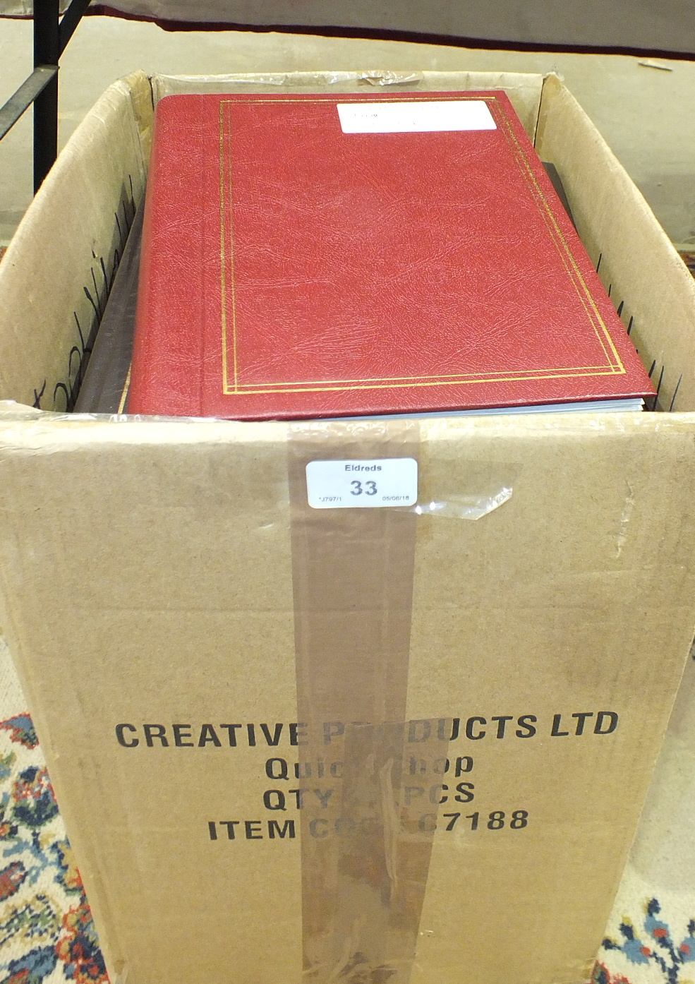 Lot 33 - A large accumulation of stamps and covers in albums, stock books and loose, contained in four boxes,