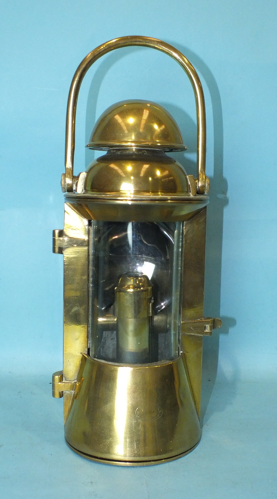 Lot 529 - A brass ship's bulkhead lamp by Bulpitt & Sons, Birmingham, with glazed bowed door and removable
