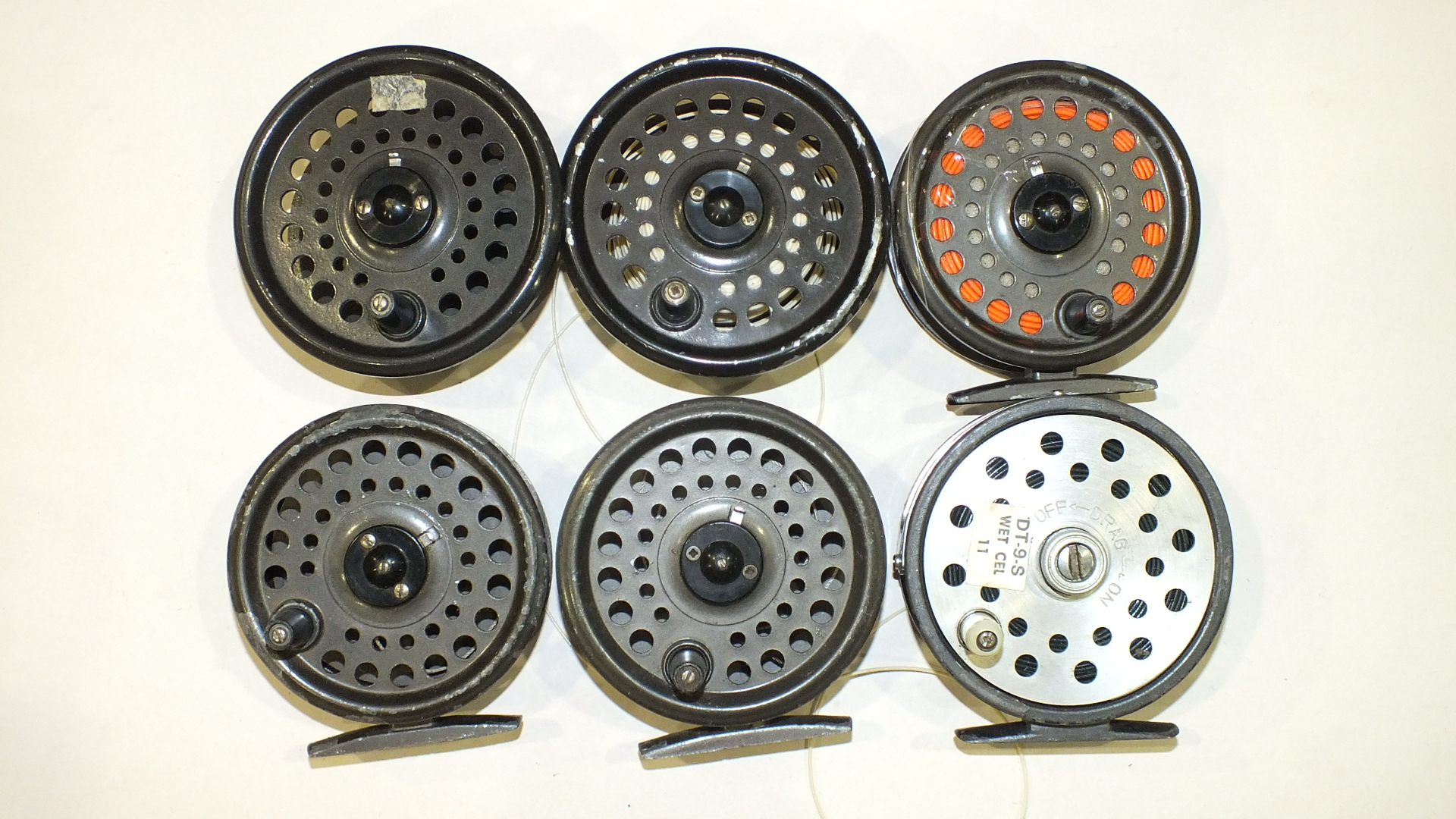 Lot 558 - Two Intrepid Rimfly fly reels with spare spools and two other fly reels.