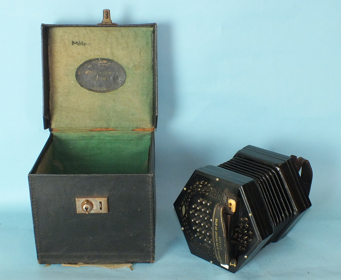 Lot 496 - A Lachenal & Co. concertina with pierced ebonised ends, 56 chrome keys and sevenfold bellows,