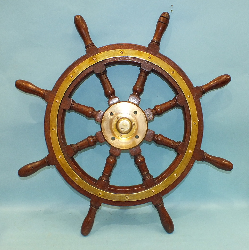 Lot 528 - A teak and brass-mounted 8-spoke ship's wheel, 77cm diameter.
