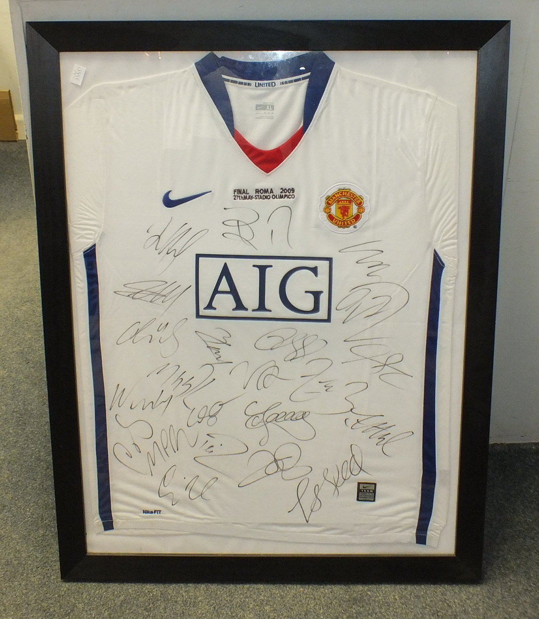 Lot 514 - A Manchester United 2009 UEFA Champions League Final shirt, signed by the team, framed.