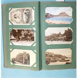 An album of approximately 300 postcards, early-20th century, mainly UK topographical.