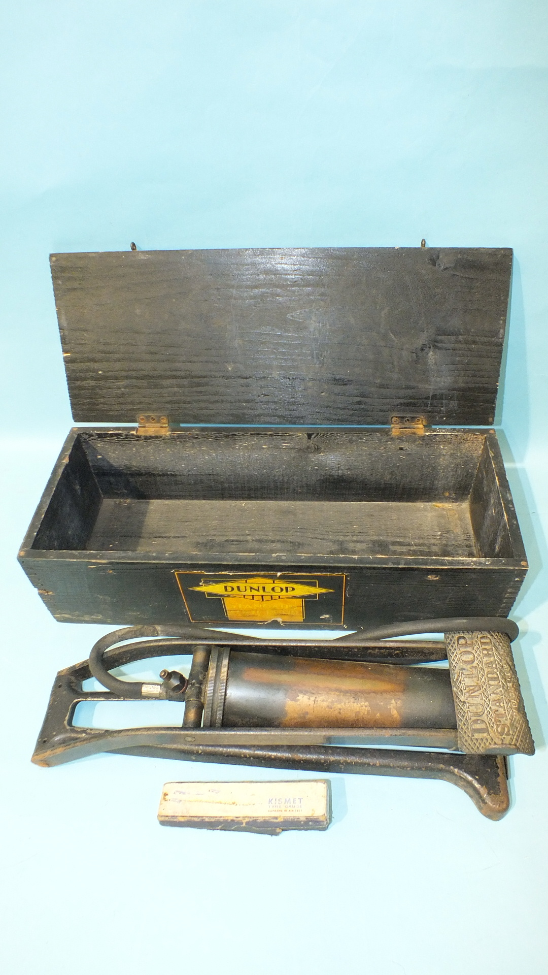 Lot 516 - A Dunlop Standard Foot Pump in original wooden box, with paper labels.