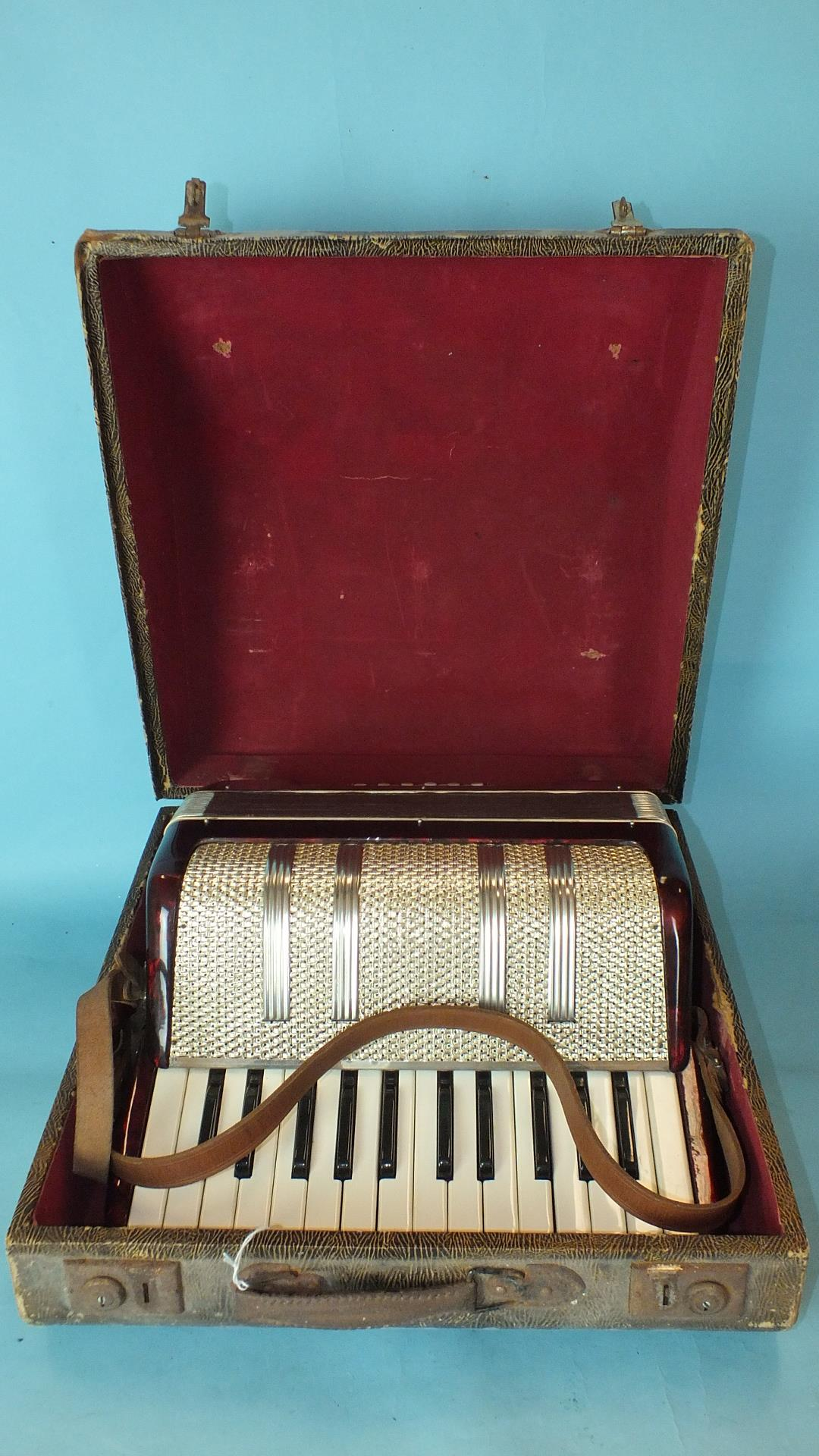 Lot 498 - A Lyca accordion, cased.