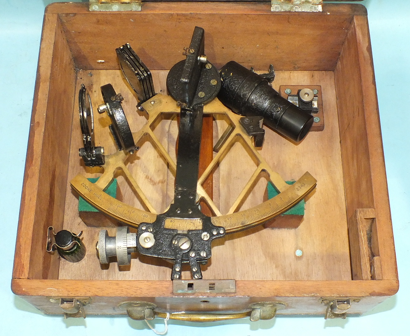 Lot 530 - A brass and blackened metal sextant numbered 2343 by Cooke, Hull, in fitted box.