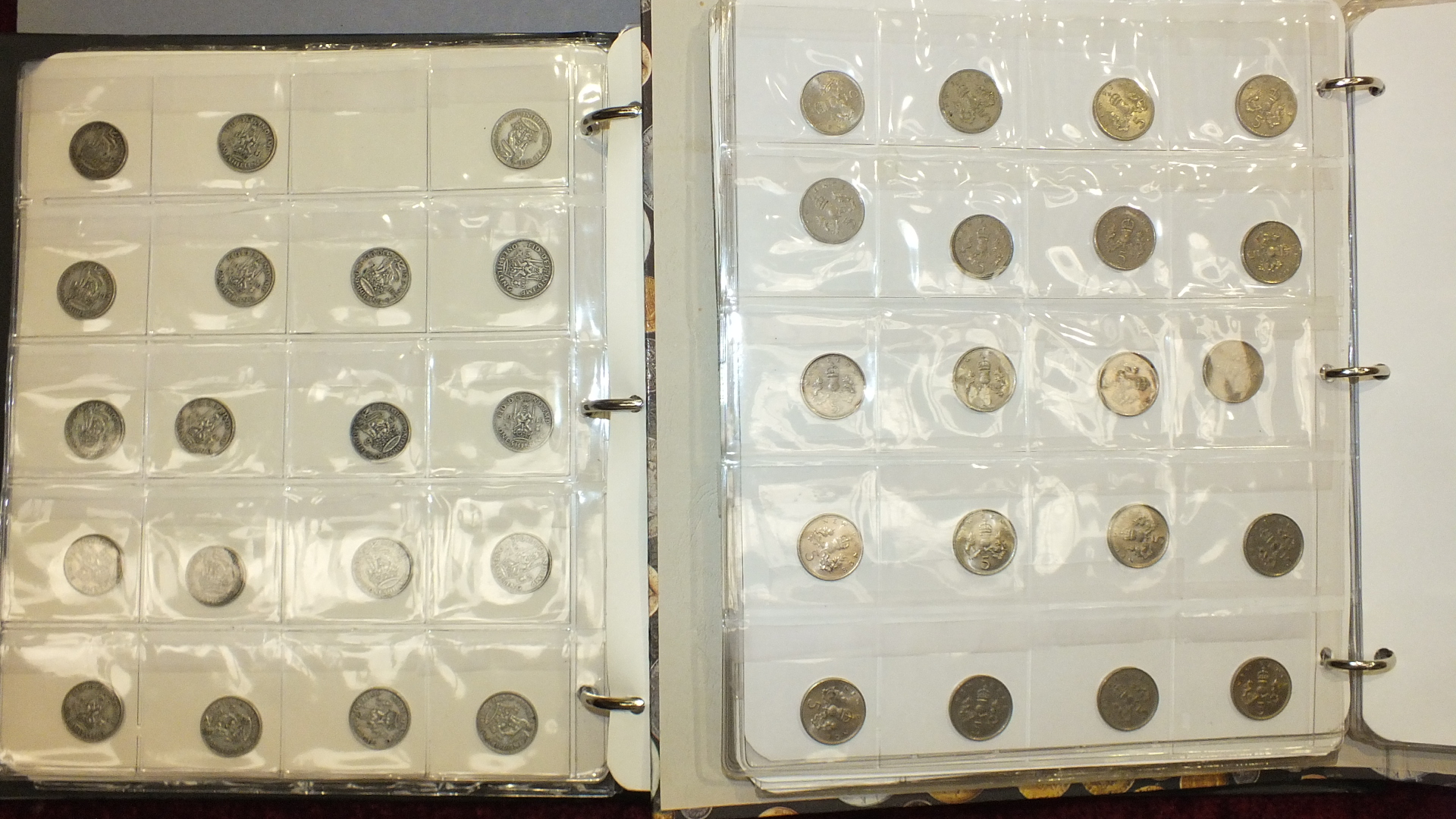 Lot 168 - A collection of British coinage contained in two albums, includes pre-1947 silver.