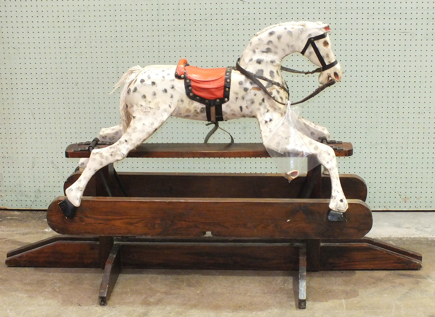 Lot 483 - A small painted rocking horse in need of restoration, horse 90cm long, 64cm high, 138cm x 83cm,