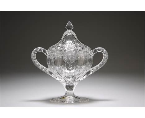 A 19TH CENTURY FRENCH GLASS SUGAR BASKET AND COVER, PROBABLY BACCARAT, oval with twin handles, impersonating rock crystal, de