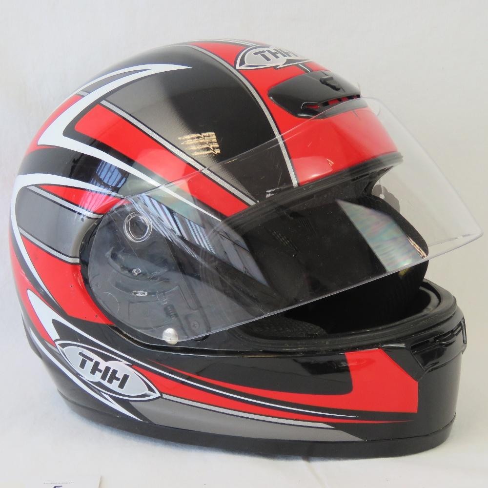 Lot 55 - A TS15 motorcycle helmet, size small, co