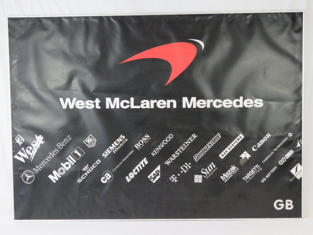 Lot 19 - A large black ground advertising poster