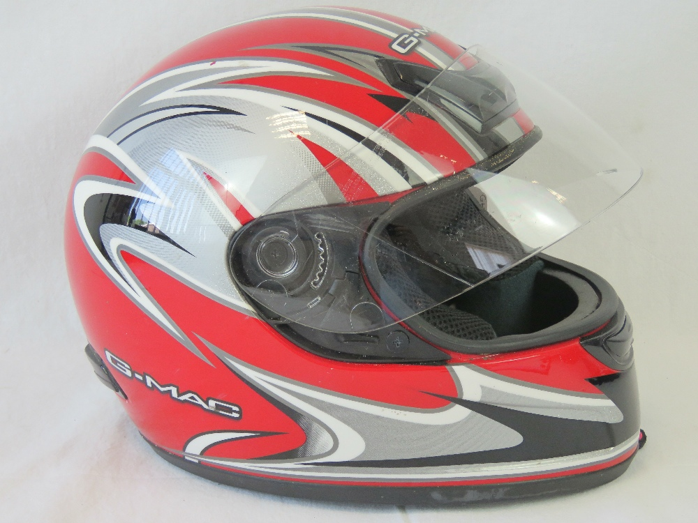 A FF311 motorcycle helmet, size small, c