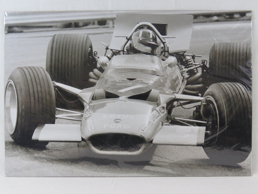 Lot 74 - A monochrome print of Graham Hill in his
