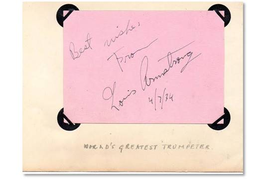 autograph page signed by louis armstrong with the words best wishes
