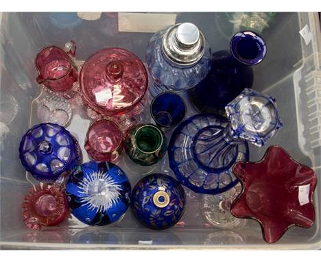 A group of coloured glass to include: Cranberry sugar bowl and cover with various similar decorated milk / cream jugs; flashe