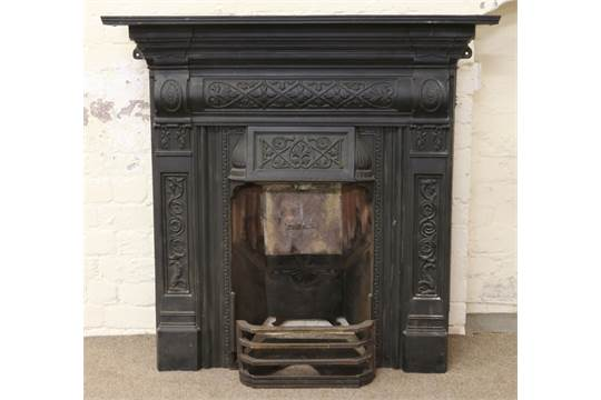 An Ornate Victorian Painted Cast Iron Fireplace With Fire Back Plate And Front Grill