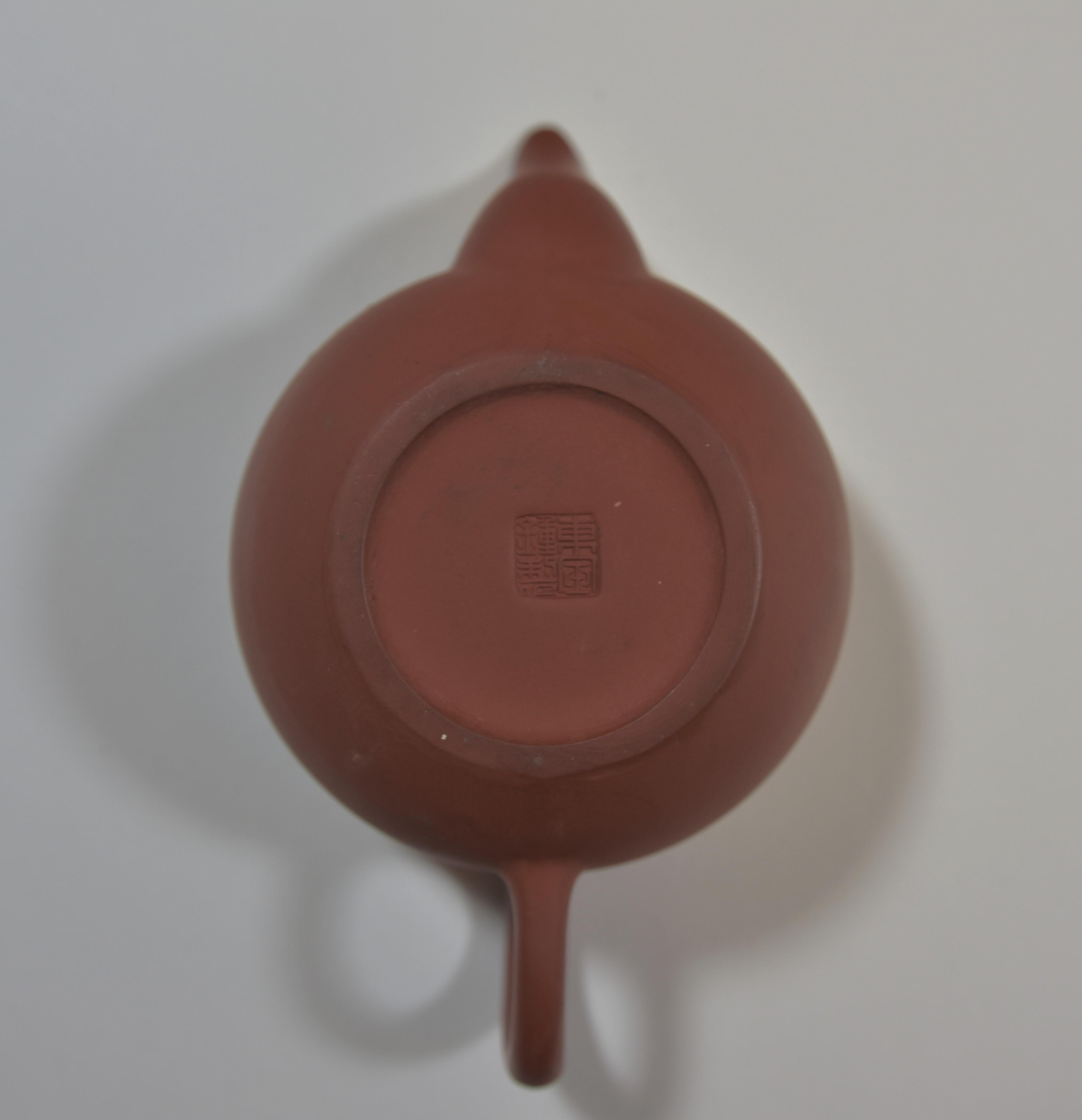 Lot 57 - A group of four Yixing tea pot宜興紫砂茶壺肆件
