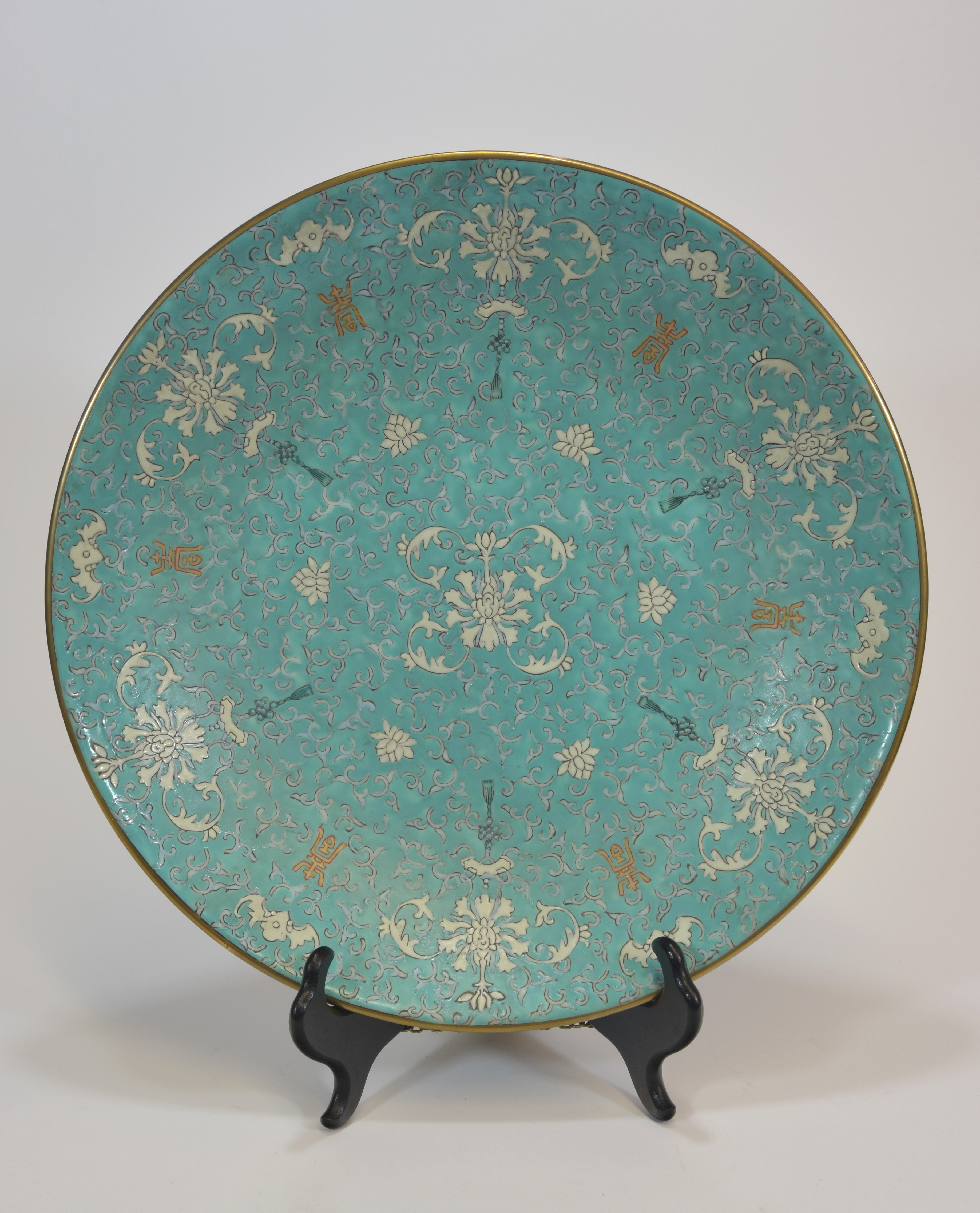 Lot 38 - A 19th century blue glazed white flower dish 33cm清 十九世紀 粉彩藍地白花碟