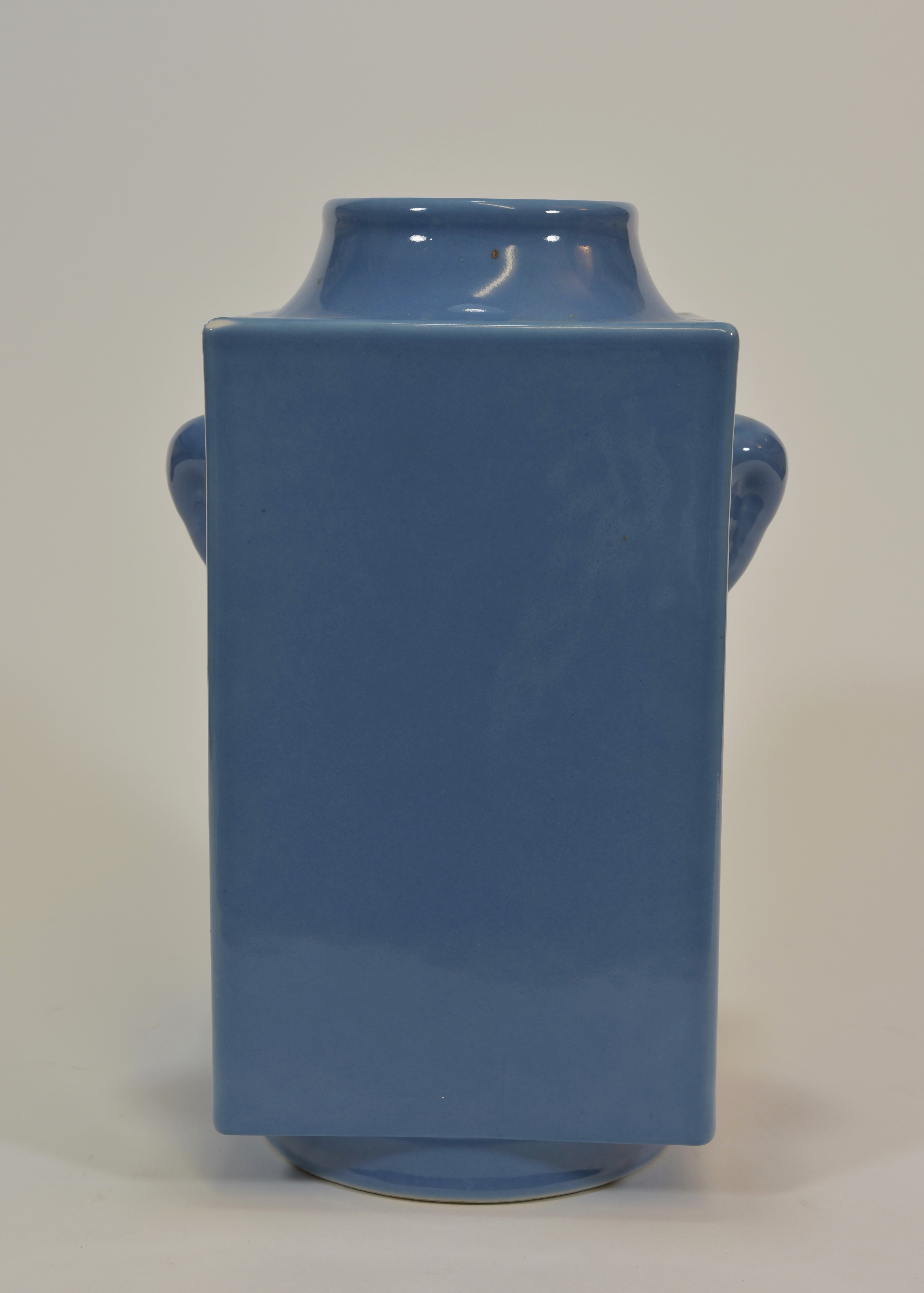 "Lot 6 - A late 19th centry blue glazed square vase Yongzheng mark 24cm tall清 十九世紀 淺藍釉獸耳琮瓶""大清雍正年制""款"