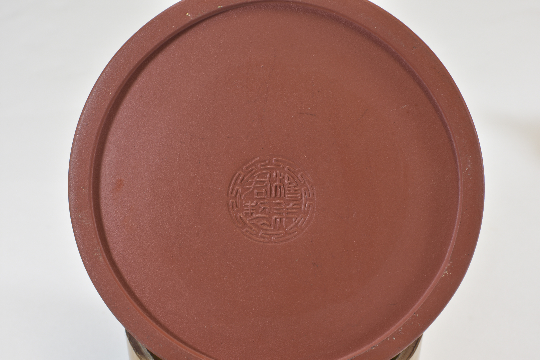 Lot 58 - Two Yixing tea pots宜興紫砂茶壺兩件