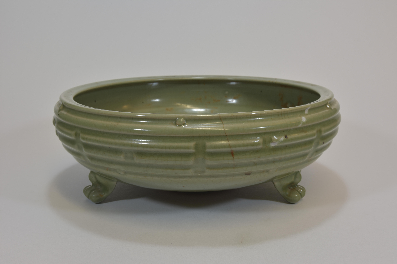 Lot 35 - A Ming dynasty celadon censor with eight Buddhist emblems 33cm明朝時期 明龍泉八卦香爐