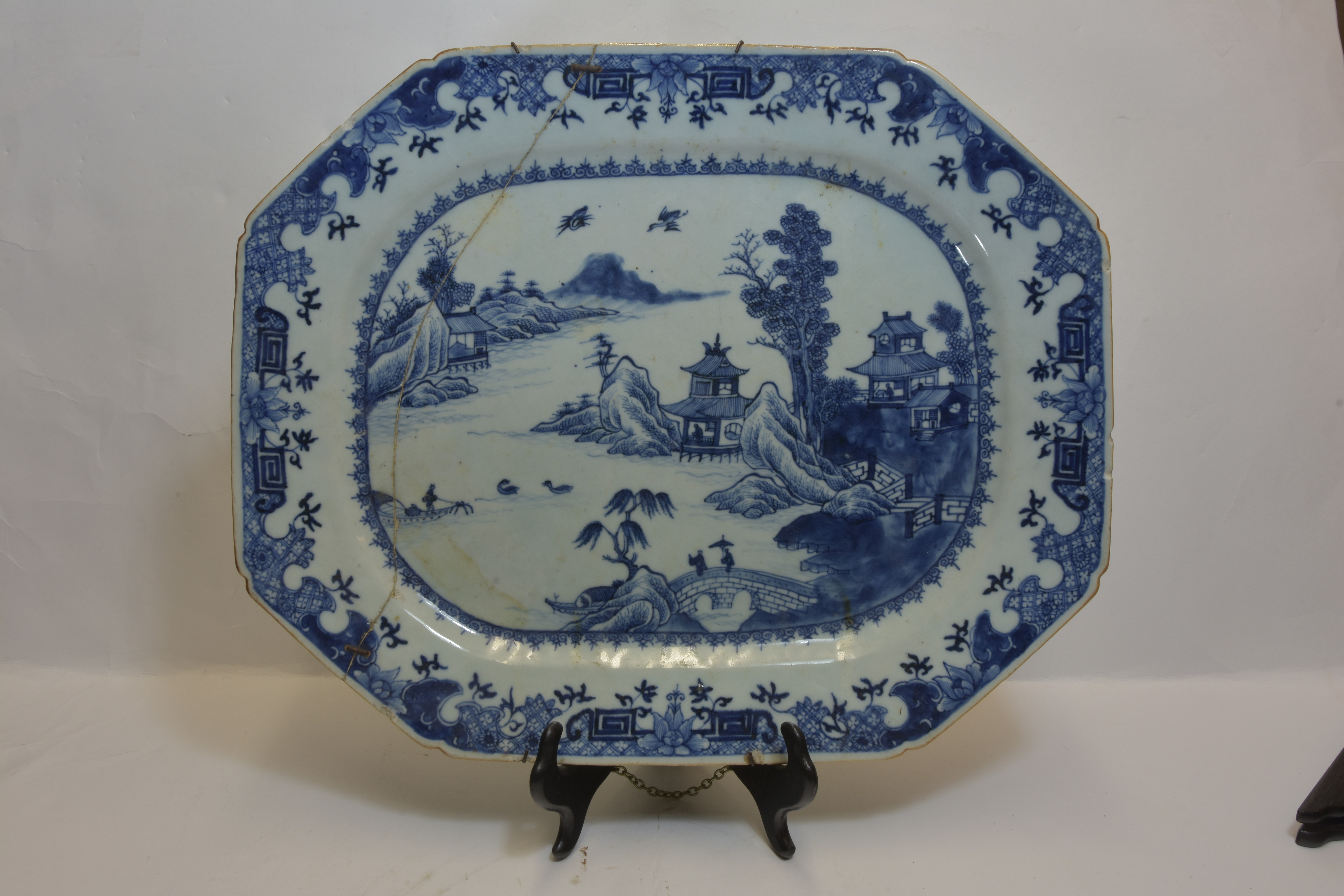 Lot 12 - An 18th century dish together with two 19th century plates 25cm diameter (3) 乾隆或遲 青花碟叁件