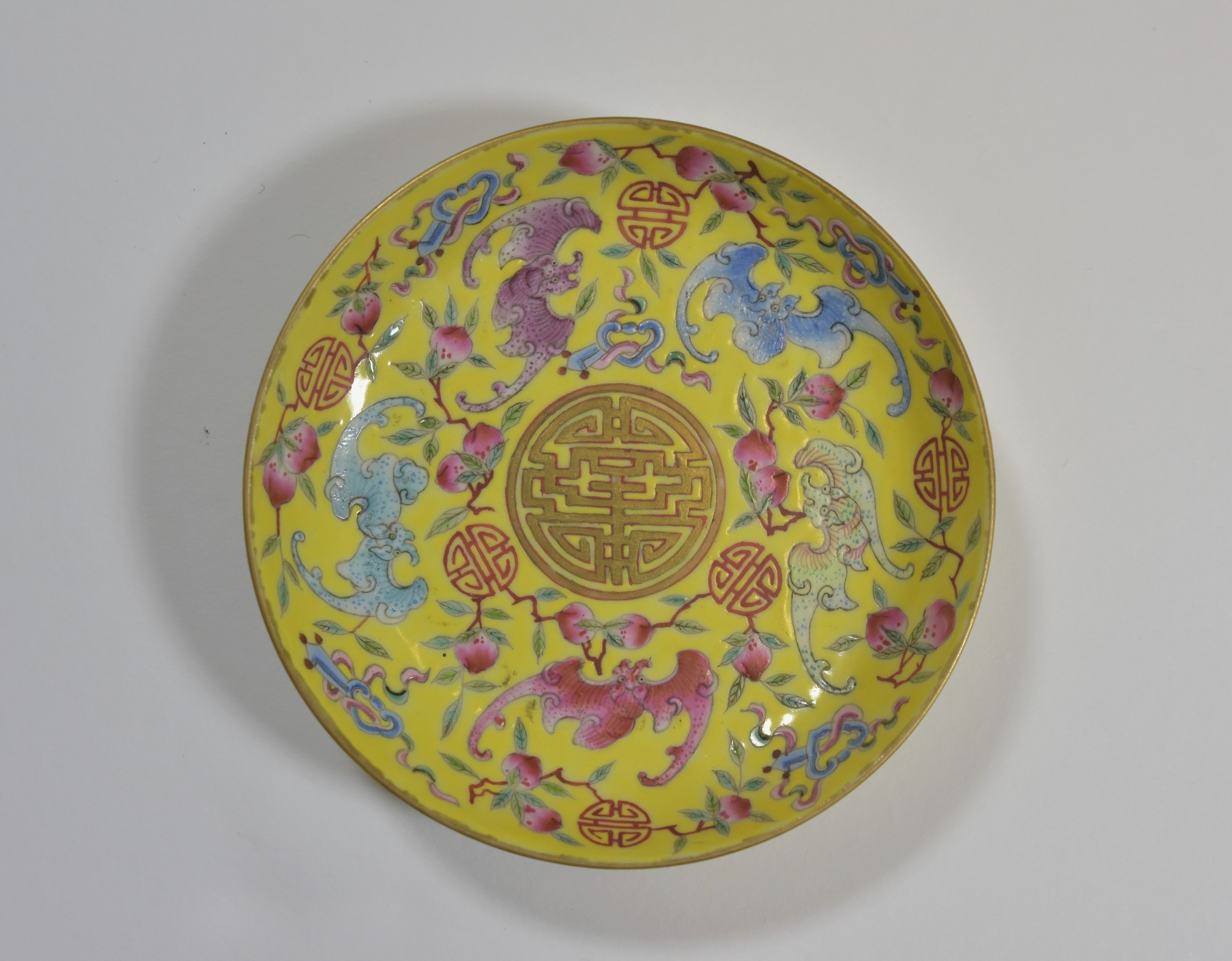 Lot 33 - A Yellow-ground birthday dish decorated with five bats and peaches . Mark and Period of Guangxu