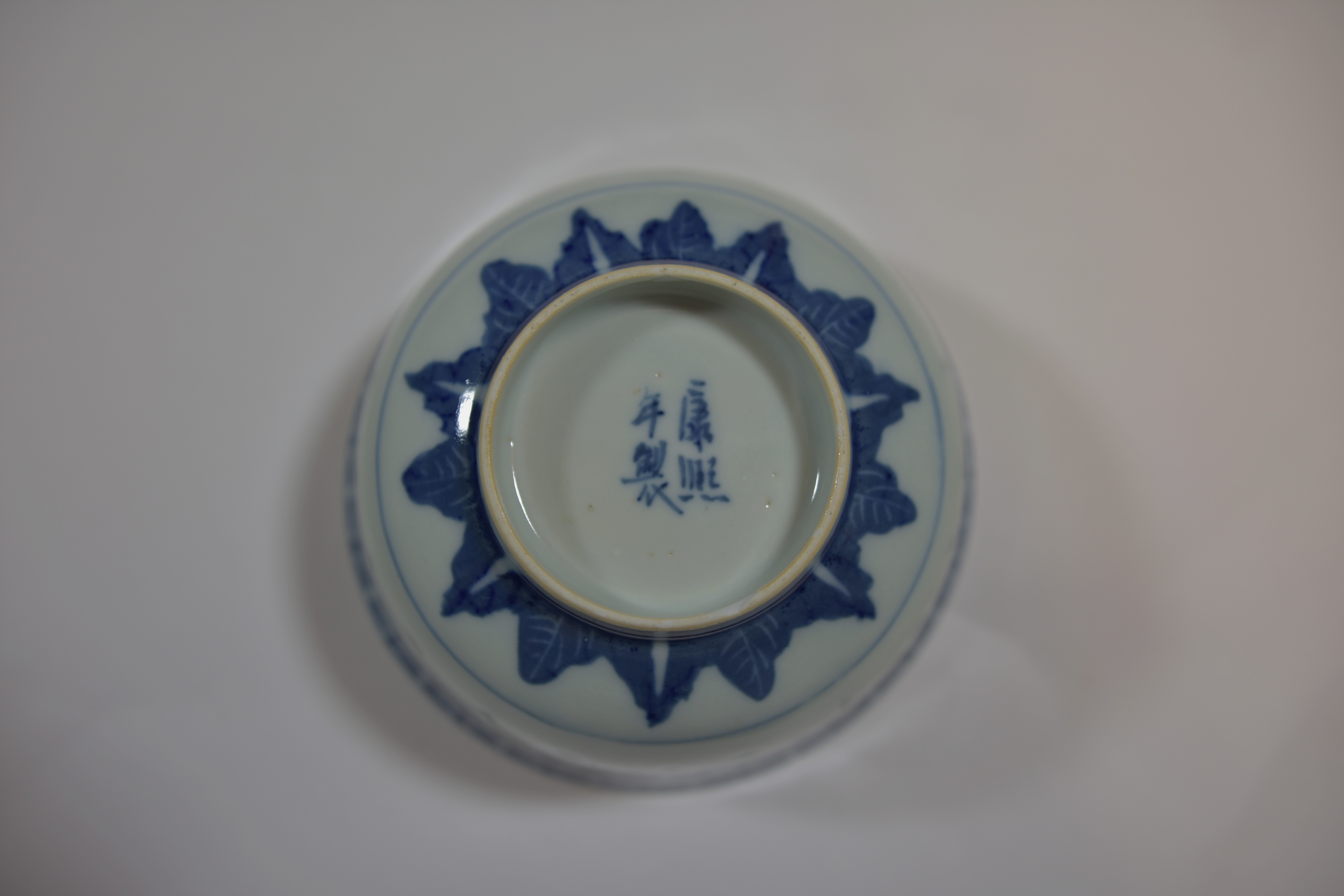 Lot 55 - Thirty nine pieces of blue and white KANGXI mark rice grain pattern of rice bowl and tea cups