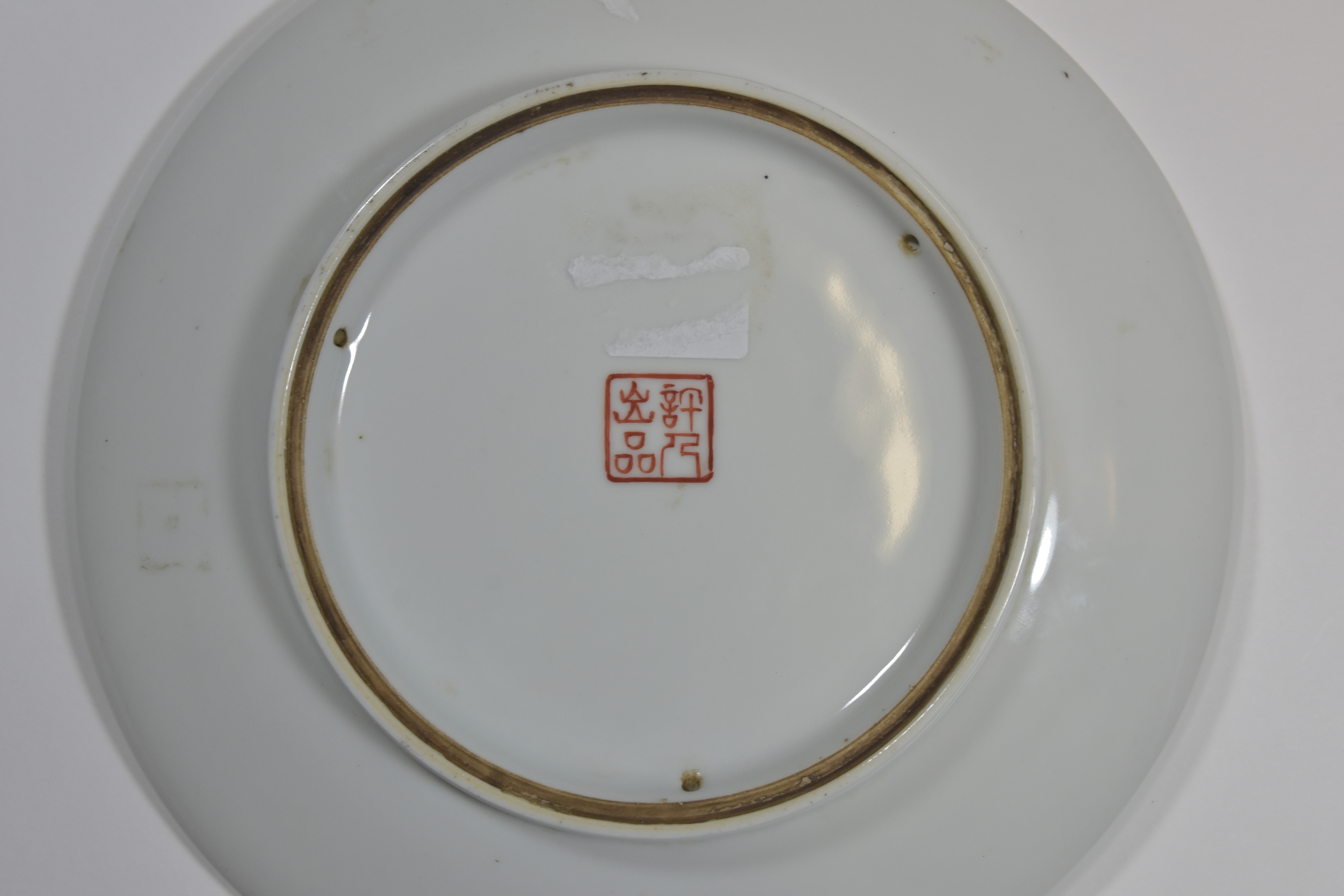 Lot 29 - A Black and White plate painted with snowy mountain scene republic of China 24cm文革時代 許人出品 黑白釉溪山瑞雪
