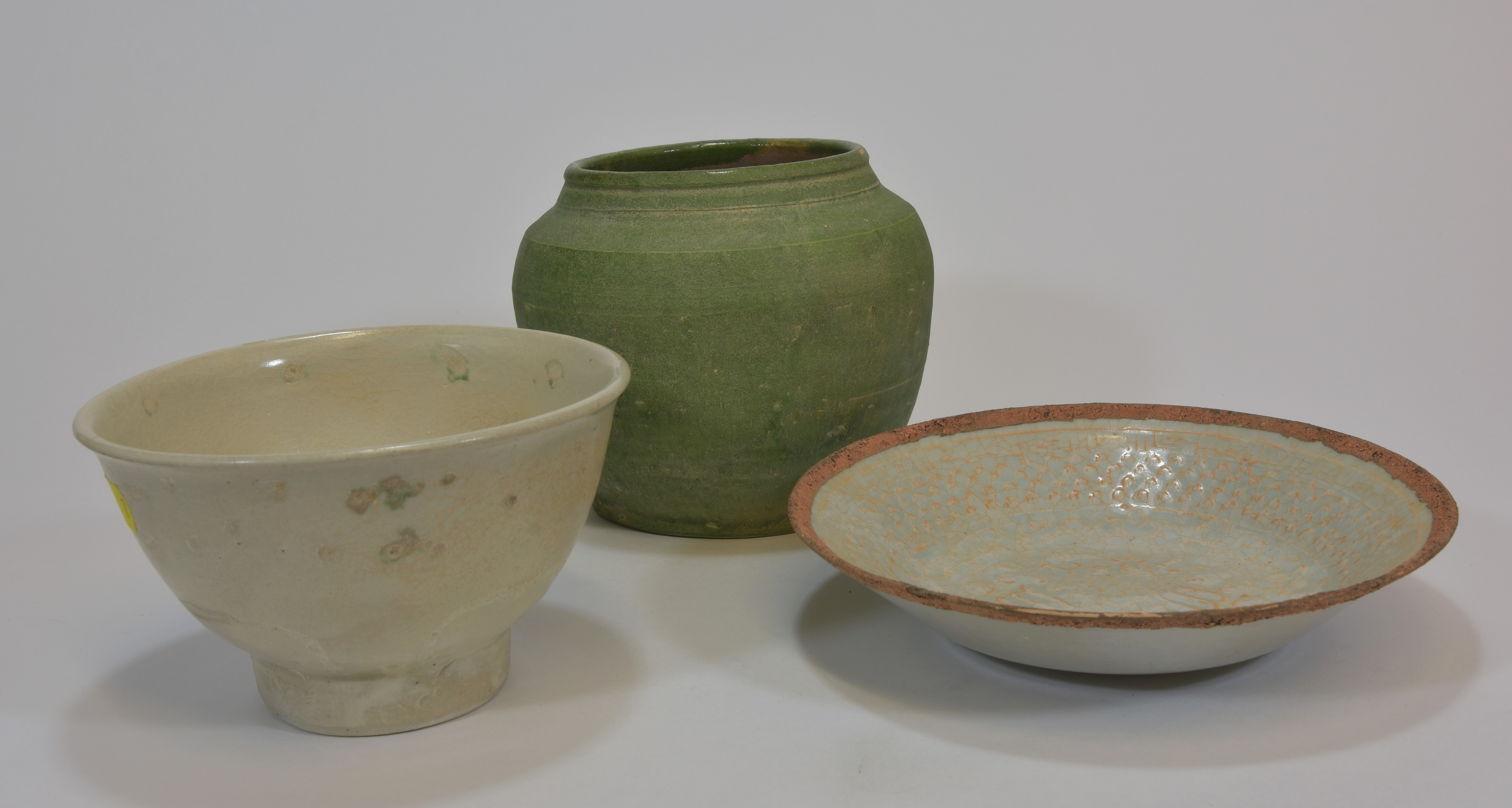 Lot 25 - A Hoi An pottery bowl and a green glazed Ming jar together with a Qingbai dish 13-15cm (3)越南碗,明青釉罐,