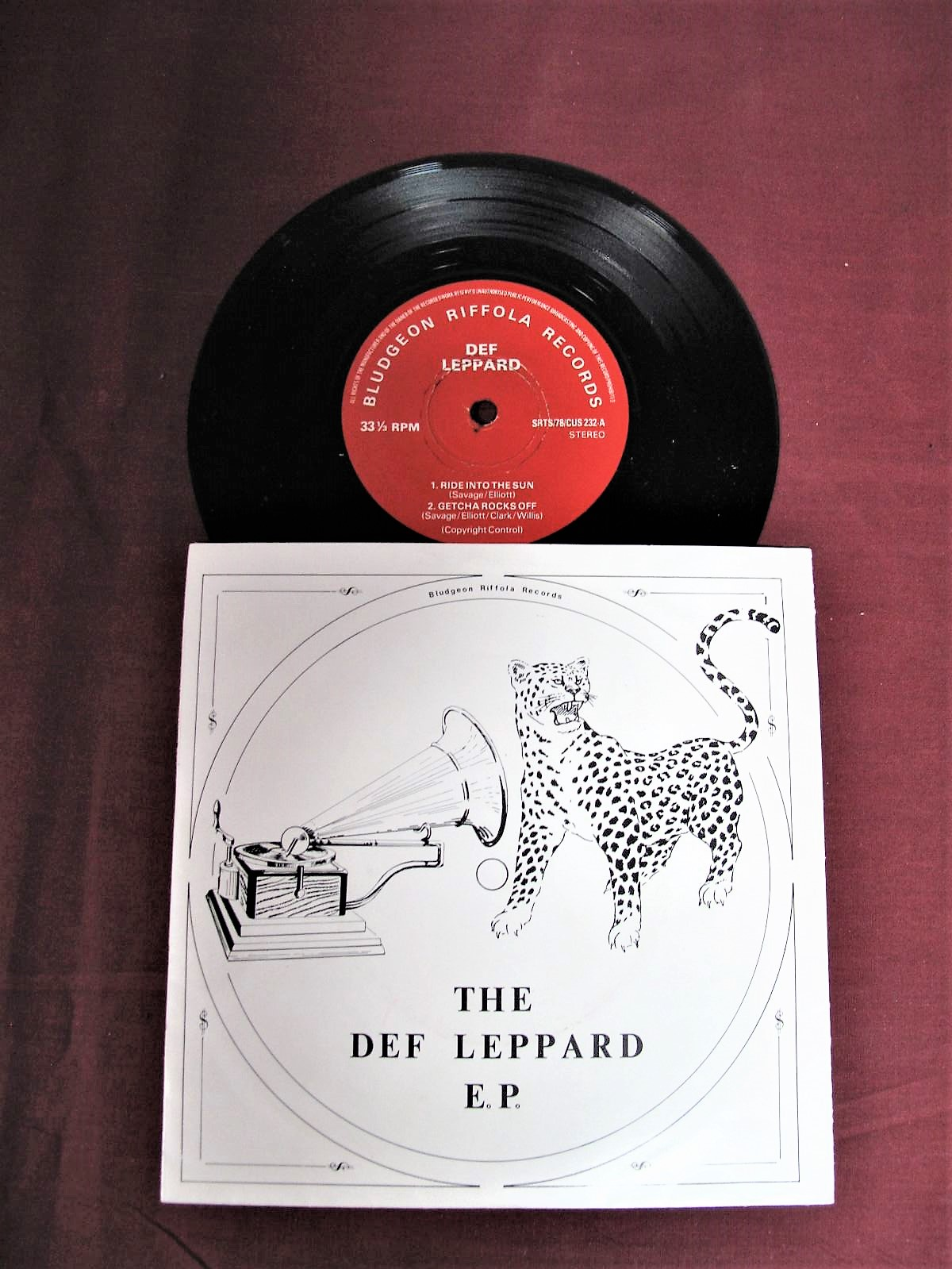 Lot 8 - Def Leppard -'Ride Into The Sun', rare first pressing EP, 1979, on the red 'Bludgeon Riffola