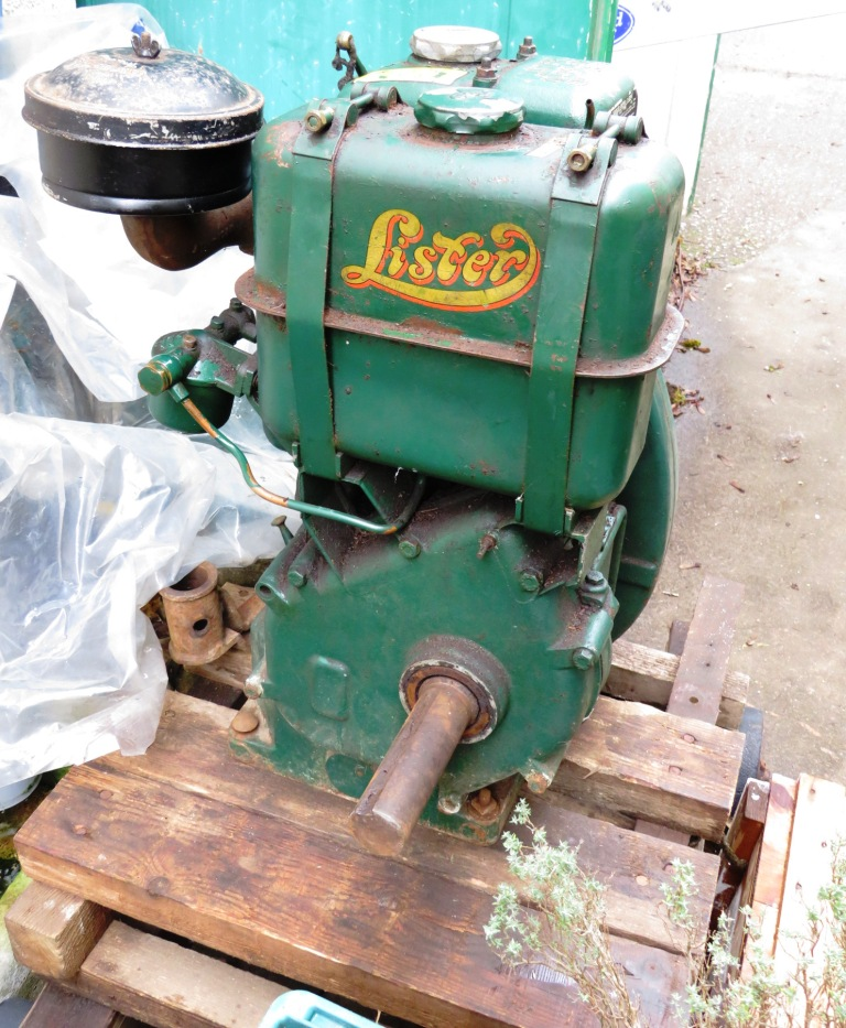 Lot 1 - VINTAGE LISTER 2HP AIR COOLED STATIONARY DIESEL ENGINE ON WOODEN PLINTH AND WHEELED TROLLEY, GREEN