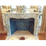 A French Louis XV Pompadour antique fireplace, finely carved in Italian Bardiglio black veined