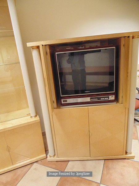 A birds eye maple tv audio cabinet with retractable top doors with reeded painted metal pillar su - Retractable kitchen cabinet doors ...