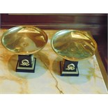 A pair of French Empire style Tazza on marble base, a single gilded bronze mounted on a square